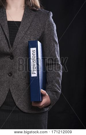 Office manager with paper folder on black background