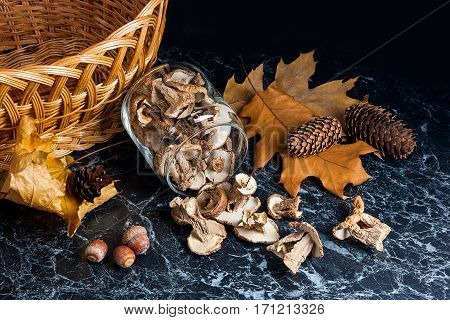 Dry Wild Mushrooms On Black Marble Background.