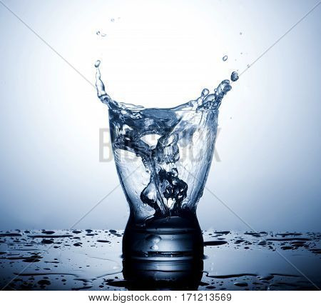 water splash in a glass on gradient background