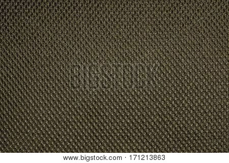 Deep yellow fishnet cloth material as a texture background. Nylon texture pattern or nylon background for design with copy space for text or image.