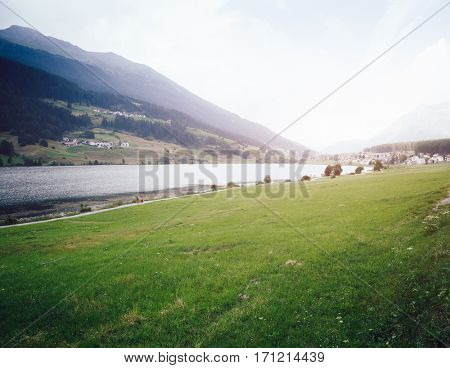 Great view of the alpine valley with Haidersee lake. Picturesque and gorgeous scene. Location place San Valentino Alla Muta village, Italy alp, Europe. Vintage toning. Instagram filter. Beauty world.
