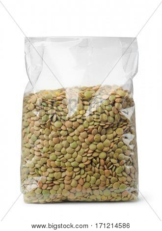Plastic packet of dried lentil isolated on white