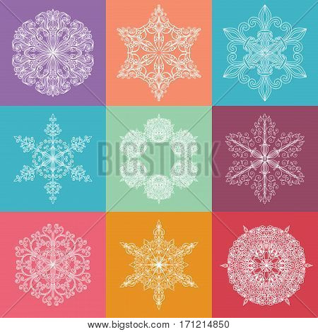 Collection of lacy elements. White decorative icons at colored squares. Fragile snowflakes. Symmetric patterns. Vector illustration.