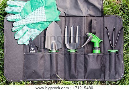 Gardening Tools in the Bag on the Grass. Concept Gardening and Agriculture. Selective Focus.