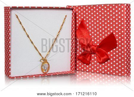 Gold silver medallion Virgin Mary on a gold chain. Souvenir gift Holy Communion placed in a red box with white dots with a red ribbon. Jewelry on a white background with slight reflection.