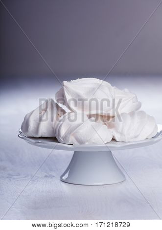 Heap of fluffy meringue on the plateau