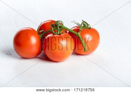 Four red fresh juicy tomatoes
