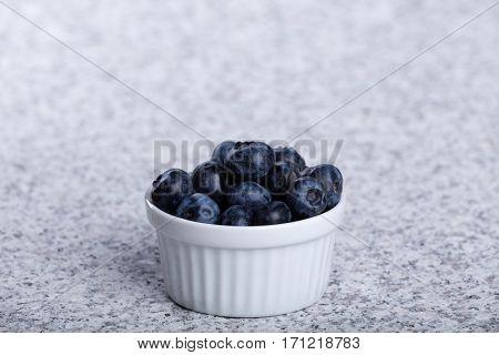 Bowl of fresh juicy huckleberries
