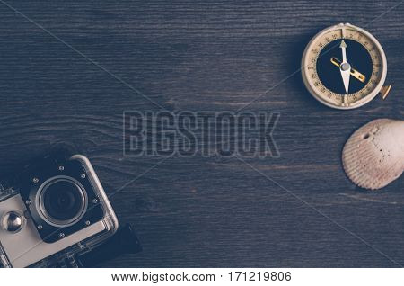 Old Compass And Action Camera On A Dark Wooden Background. The Concept Of Direction Or Travel