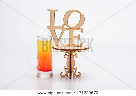 Alcohol Cocktail In Glass On Little Decorative Table, Love Inscription