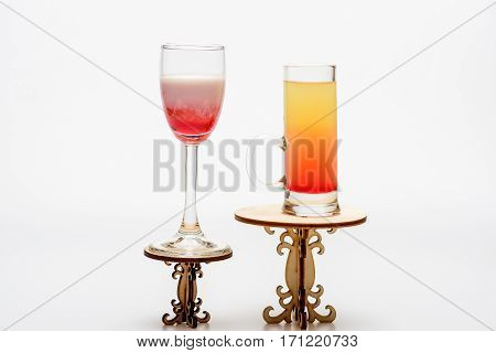 Cocktails: Sex On The Beach, Singapore Sling On Decorative Tables