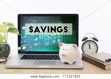 Savings homepage on the computer screen in workplace. business finance concept.