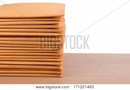 Stack Of Bubble Wrap Padded Mailing Envelopes On White Background Color Over Wooden Table. Envelope