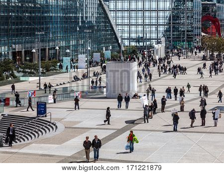 Paris,France-April 19th 2012: People walking in front of CNIT building in the downtown of La Defense the main business district in Paris.