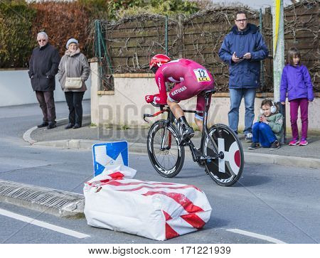 Conflans-Sainte-HonorineFrance-March 62016: The Norwegian cyclist Sven Erik Bystrom of Katusha Team riding during the prologue stage of Paris-Nice 2016.