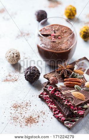 Sweet and treat, junk unhealthy food. Assortment of chocolate bar and praline truffle and mousse