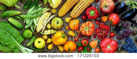 Green, Yellow, Red, Purple Fruits And Vegetables On Wooden Background