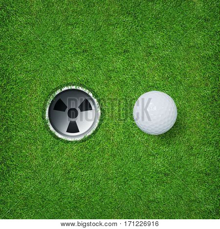 White golf ball and golf hole on green grass of golf course.