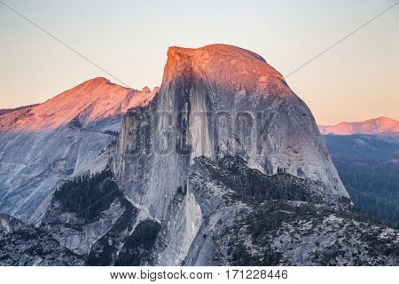 Classic view of famous Half Dome illuminated in beautiful golden evening light at sunset on a beautiful sunny day with blue sky in summer Yosemite National Park California USA