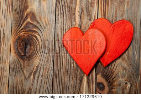 Holidays gift and heart on wooden rustic background. Valentines day