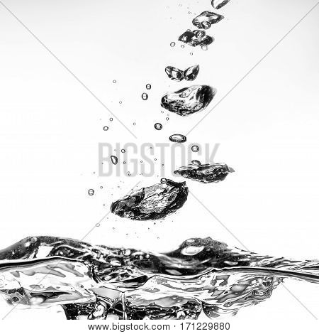 splashing water with bubbles on white background close-up
