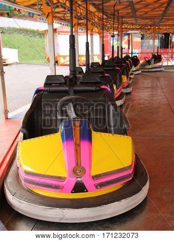A Row of Dodgem Cars on a Fun Fair Ride.