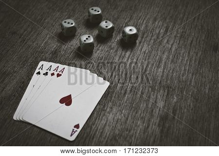four aces playing cards and dice with copyspace game abstract background