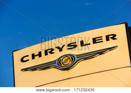La Rochelle, France - August 30, 2016: Official Dealership Sign Of Chrysler Against The Blue Sky. Ch
