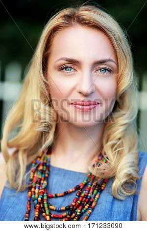 beautiful adult blond woman portrait outdoor smiling