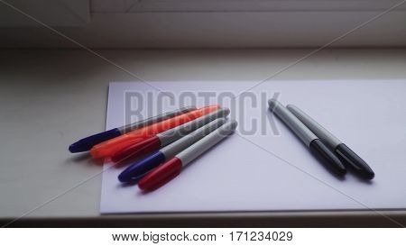 colored markers on a white sheet of paper