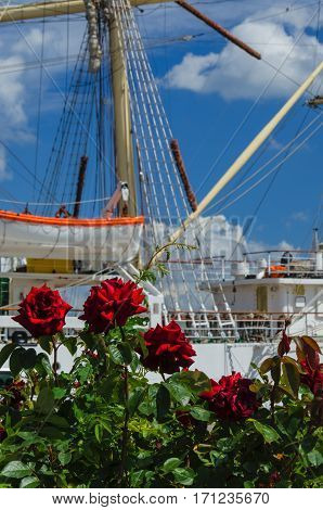ROSES, WHITHE FRIGATE AND CUMULUS CLOUDS - Summer coastal city