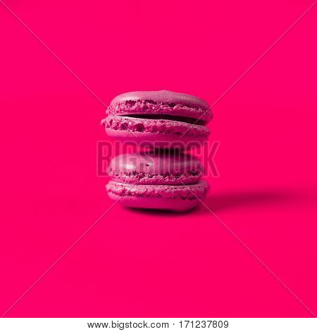 pink sweet  cookies macaron on colorful background
