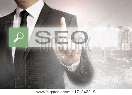 Seo Browser With Businessman And City Concept