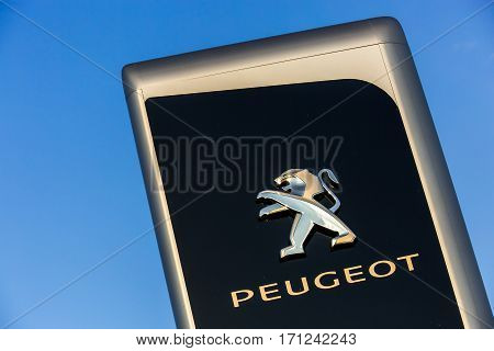 La Rochelle, France - August 30, 2016: Official Dealership Sign Of Peugeot Against The Blue Sky. Peu