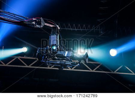 TV camera on crane on concert. TV camera