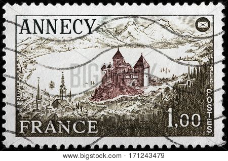 LUGA RUSSIA - FEBRUARY 7 2017: A stamp printed by FRANCE shows beautiful view of Annecy - city in southeastern France on the northern tip of Lake Annecy circa 1977