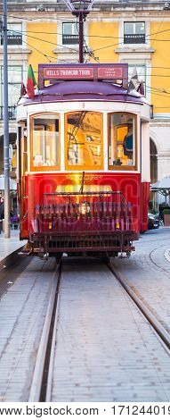 LISBON PORTUGAL - JANUARY 10 2017: Old tram on the Praca do Comercio (Commerce Square) in Lisbon Portugal.
