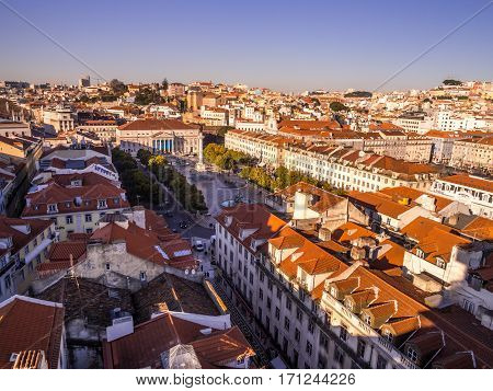 LISBON PORTUGAL - JANUARY 10 2017: Cityscape of Lisbon with Dom Pedro IV square as seen from Miradouro do Elevador de Santa Justa (view point at the top of Santa Justa Elevator).