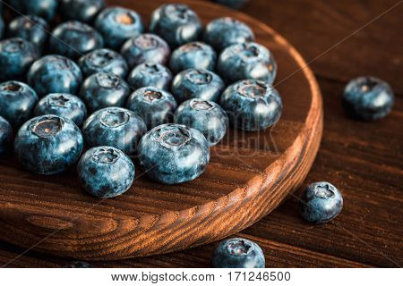 blueberry on cutting board on wooden background