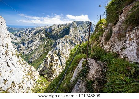 Scenic trail in summer mountains, mountain trails at high altitude