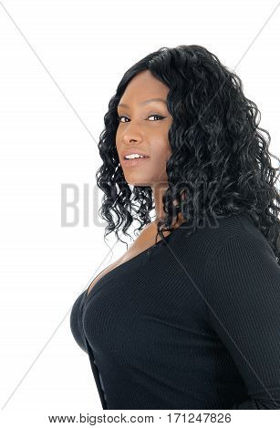 A closeup profile portrait of an African American woman in a black dress with big boobs isolated for white background.