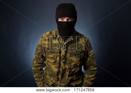 Terrorist On Dark Background