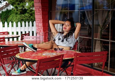 Girl in outdoor cafe during the day shot