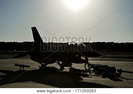 Fighter aircraft with ammunition and missiles on the runway
