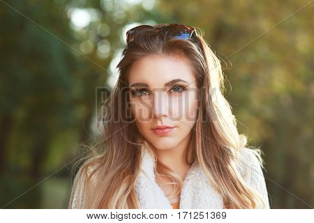 beautiful woman portrait outdoor with early autumn park background