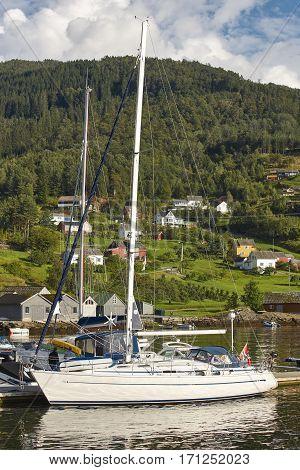 Norwegian fjord village with harbor. Hardanger road route. Jondal. Travel background