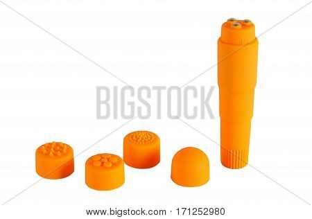 Orange masseur with a set of caps isolated on a white background