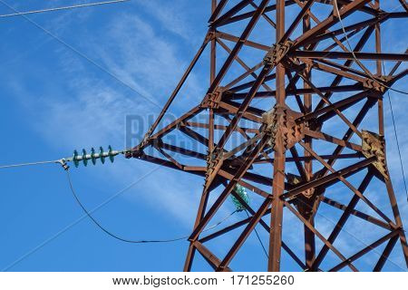Supports High-voltage Power Lines Against The Blue Sky With Clouds. Electrical Industry
