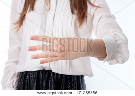 girl stretched forth a hand and four fingers shows