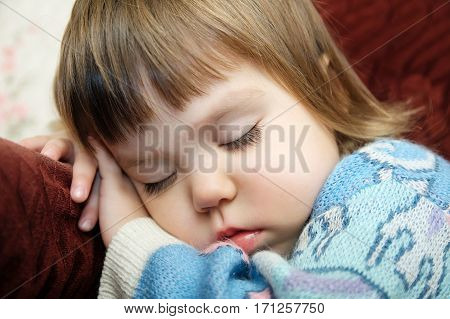 Exhausted child sleeping portrait on chair closeup tired kid fall asleep after playing